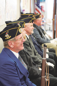 A group of local veterans (l-r) Butch Fink, Bruce Jolley, Terry Wilkerson and others participate by acting as color guard at a special Veterans Day event hosted by the North Big Horn Senior Center on Monday.  Patti Carpenter photo