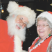Mrs. Santa Claus (Judy Quarles), chats with her once-a-year husband, Santa, while sitting in the window of the Hen House during the 2012 Holiday Mingle.