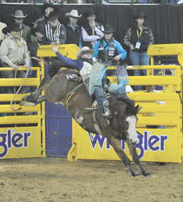 Bareback rider JR Vezain, who is currently ranked sixth in the standings, is competing at the Wrangler NFR Rodeo in Las Vegas Dec. 5 – 14.   Photo courtesy of Wrangler National Finals Rodeo/Dan Hubbell