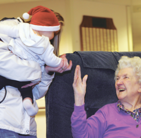 Baby Ashlynn Hitz greets elder Inga Petersen at the Children's Creative Christmas event held on Saturday, Dec. 7, at the New Horizons Care Center in Lovell. Patti Carpenter photo