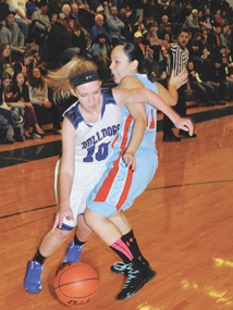 Lovell senior Kassi Renner drives around a Wyoming Indian defender during Lovell's 54-45 win Thursday night.  David Peck photo