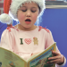 Narrator Maecie Joy reads the story of the Gingerbread Man, as students from Mrs. Geiser's first grade class act out various roles in the story. Patti Carpenter photo