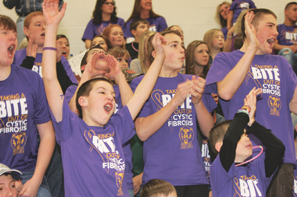 A group of Rocky Mountain High School fans cheer on their teams during a special purple fundraising event held on Friday night in Cowley. The event was held in conjunction with the varsity basketball games. Patti Carpenter photo