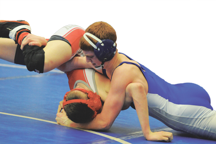 Lovell 120-pounder Joey Bassett puts the hurt on Justin Winkelman of Big Piney during a quarterfinal match Friday at the 2A West Regional Wrestling Tournament hosted by Lovell High School last week. Bassett pinned Winkelman in 58 seconds and went on to place second. Wrestlers are off to the state tournament in Casper this week. David Peck photo