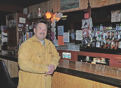 Dave Fink poses proudly at the new bar in the Shoshone Bar, part of the four-month extensive renovation he made at the establishment during the fall of 2012. David Peck photo