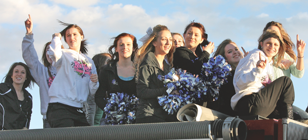 The Lovell High School spirit squads rode into town atop a fire truck Thursday evening after winning top Class 3A trophies during the competition Wednesday, March 12. Pictured are (l-r) dance coach Sara Green, Amber Mayes (hidden), Heather Bartling, Whitney Grant (hidden), Camille Ohman, Shandelle Allred, Jordan Harper (hidden), Ashton Dickson, Lauren Stewart, Ashley Steenbakkers and Chelby Lewis (hidden).  Patti Carpenter photo