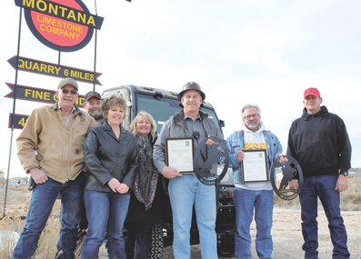 Pictured with the new Town of Frannie Kubota that a donation from Montana Limestone Co. helped to fund are (l-r) Mike Jones, Vance Peregoy, Jean Loyning, Faye Miller, Kurt Kiser, Bob Bartosh and Shang Clendenen. The seven gathered for a presentation Tuesday, March 25, in Warren, Mont. David Peck photo