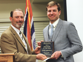 Rocky Mountain High School Principal Tim Winland presented the Outstanding Educator Award for School District No. 1 to RMHS English teacher John Samuels at the Lovell Area Chamber of Commerce awards banquet on Friday, April 11. Patti Carpenter photo