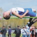 Lovell senior Kade Englert clears the bar in the high jump Saturday in Lander. Englert placed fifth with a jump of 6 feet.