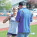 Whitney Grant was pumped after winning the pole vault competition at the state track meet, besting her own school record with a vault of 10-2. Celebrating with her Friday morning is vaulting coach Daniel Robertson. David Peck photo