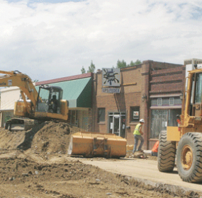 Patti Carpenter An excavator and front end loader work on Main Street in Lovell last week. A traffic detour is now in place from Pennsylvania to Shoshone as crews work their way west with the street repair and water and sewer line project.