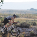 Winner of the Big Horn Canyon Triathlon, Ladell Merritt, races toward the staging area on his bicycle on Saturday, July 19, at Horseshoe Bend.
