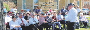 A large crowd gathered at the historic Cowley Town Hall Saturday for the dedication of the Korean War plaque, as shown by this photo taken during Bob Baird's keynote address.