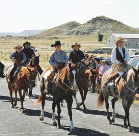 Members of the family oriented Wyoming Desperados, whose members come from Lovell, Cowley, Greybull, Emblem, Powell, Cody and Frannie, amoung other Big Horn Basin communities, rode in the Clark Jubilee parade earlier this summer and later demonstrated their riding and shooting skills in the Clark area. Members shown are (l-r) Mark Urlacher, Stetson Davis, Cal Bottolfson, Cole Davis, Candice Davis and Scooter Singbeil.