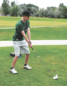 Lovell junior Hunter Tippetts prepares to tee off during golf practice Tuesday evening at the Foster Gulch Golf Course. The Bulldogs open the season in Sheridan this week.