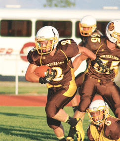 Rocky Mountain junior running back Cordell McFarlane runs for daylight during Rocky Mountain's Brown and Gold intrasquad scrimmage Friday evening. The Grizz host Tongue River to open the season Friday at 7 p.m.