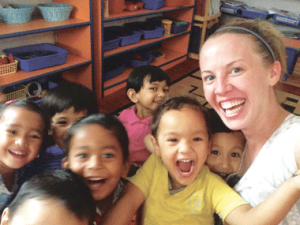 Recent University of Wyoming graduate Lauren Carlisle of Lovell poses with children in her class during her early childhood education internship in Nepal this summer.