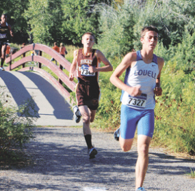 Lovell freshman Brent Snyder and Rocky sophomore Dominic Twomey stride out during the Billings Invitational Friday afternoon. Both placed in the top 10 in the junior varsity race.