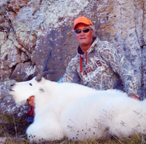 Chad Heiser poses with the mountain goat he successfully harvested Sept. 6 in the Beartooth Mountains on Line Creek. The Lovell man called it the opportunity of a lifetime.