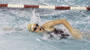 Alea Mayes swims in the 100-meter freestyle event at a middle school dual meet in Lovell on Thursday, Nov. 6.