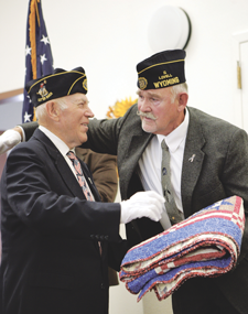 "Veteran Terry Wilkerson presents a ""Quilt of Valor"" to his uncle Frank Wilkerson, during a special event held at the North Big Horn Senior Center on Tuesday, honoring veterans in the community. Patti Carpenter photo"