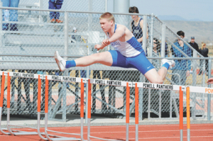 Lovell senior Eston Croft glides over a hurdle during the 110-meter high hurdles event at the L.A. Kohnke Invitational in Powell on April 11. The Bulldogs will compete at the Bobcat Invitational in Thermopolis on Friday. Photo by David Peck