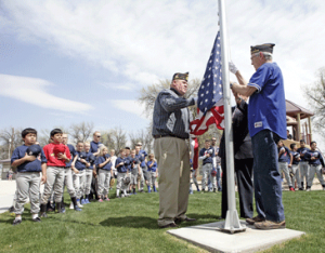 Veterans Rich Fink, Frank Wilkerson and Jack Nichols raise the flag at the Northeast Little League Complex in Lovell, during youth baseball opening day festivities on Saturday, May 2. Photo by Patti Carpenter