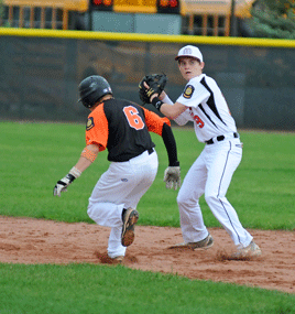 Cole Wambeke looks to turn two after recording an out at second base during Lovell's 5-2 loss to the Powell Pioneers Monday evening.  David Peck