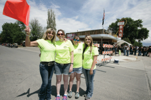 Members of the Big Horn County Search and Rescue team and others like (l-r) Cindy Allred, Keri Wilske, Shyann Wilske and Shene'a Allred helped direct traffic to ensure the safety of those passing through Lovell on Saturday during  the annual Cancer Run in Lovell. Patti Carpenter photo