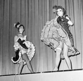 "Two of the original Lovell can-can dancers – Deanna Wagner, left, and Arlene Sessions (now Ross, right) perform their olio to the song ""Can Can"" during the 1965 western melodrama staged by the Lovell Woman's Club. The can-can dancers became a regular act and were later named the Dollies of the Follies. File photo"