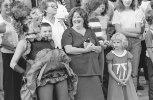 Dolly Lynne Strom whoops it up in front of the Hyart Theatre prior to the Follies in 1983, much to the delight of the crowd. File photo