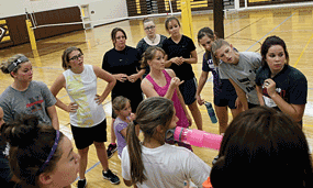 Varsity coach Jamie Cooley chats with a group of Lady Grizz volleyball players after a practice this week. Patti Carpenter Photo
