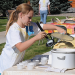 Maddie Campbell samples some chili during the Steven Muller fundraiser Saturday at the care center. The chili cook-off was tasty and drew several contestants. Winners were Brandy Tippetts, Julie Watson (a tie for white chili) and Rob Long. David Peck photo