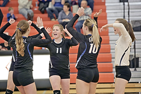 A group of Lady Bulldog players let out a cheer after scoring a point against the Lady Broncs on Friday, Oct. 30. Patti Carpenter photo