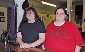 Deb Harmer (left) and Krystl Buchholtz pose at their new store at 210 E. Main in Lovell. The Attic Space opened Monday. David Peck photo