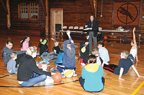 Jane Holman of Leathers and Associates quizzes kids about their playground ideas for the planned Cowley Family Park during a brainstorming session Oct. 31 at the log gym in Cowley. David Peck photo