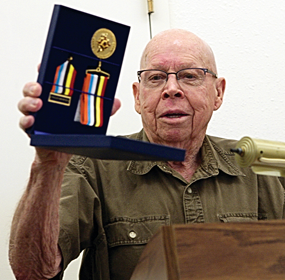 "Bob Baird shows an ""ambassador of peace"" medal he was awarded by the Republic of Korea for his service and sacrifice during the Korean War. The special medals are available for a limited time to veterans of the Korean War. Patti Carpenter photo"