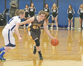 Lady Grizz player Livia Higgins dribbles past Lovell's Charri McArthur during the game between the local foes on Dec. 12 at Winterholler Gym. Patti Carpenter photo