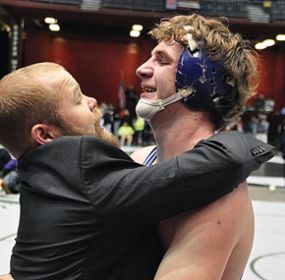 Winning an individual title was Merrill Beck, being hugged by LHS coach Nick DeWitt. Saturday night after the championship round of the State Wrestling Tournament. Nathan Oster photos