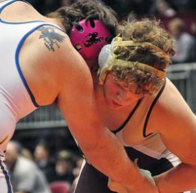Junior Garrett Vezain battles for the 220-pound state title against a Shoshoni opponent.