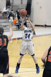 Lovell junior Emily Snell pops a jumper against the Powell Panthers in the third-place game Saturday afternoon in Afton. Snell played a valuable role for the Lady Bulldogs during the tournament, coming off the bench to work in  the post. David Peck photo