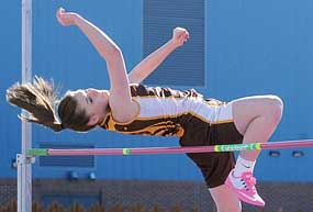 Rocky Mountain junior Mya Meier soars over the bar during the high jump competition at the Bill Gerrard Memorial meet in Greybull Saturday. Meier won the high jump by clearing 4-8. Lisa Kunkel photo