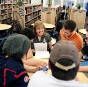 Lovell High School Speech and Debate team coach Deb Fink and assistant coach Jason Zeller go over season results on Tuesday, March 22 in the school library  with students Mikayla Thompson, Anthony Ballard, Alecx Christensen and Xaviar Allen. Patti Carpenter photo