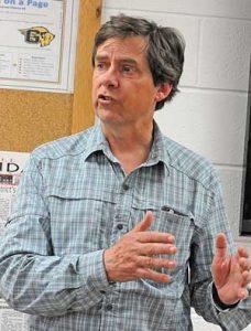 Scott Acton speaks in Greybull on April 11.