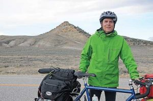 Physicist and space telescope scientist Dr. Scott Acton poses just south of Bridger, Mont., the morning of April 13 before resuming his round-the-world bicycle tour. David Peck photos