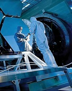 Ball Aerospace's Jake Lewis is reflected in one of the mirrors on a James Webb Space Telescope array that was in the X-ray and cryogenic facility for testing. Courtesy photo