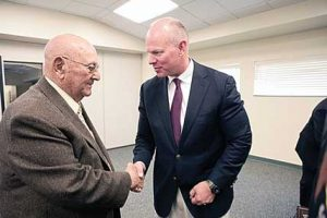 Gov. Matt Mead greets World War II veteran Bill Fink of Lovell near the end of the Governor's Welcome Home Day celebration at the Lovell Community Center Friday. See more photos of the event on page 6. Patti Carpenter photo