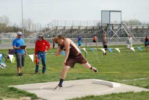 Rocky Mountain High School junior Zac Zier fires the shot during the Lovell Invitational April 23. Zier shattered his own school and personal record in the discus Friday in Thermopolis with a throw of 158-11½. Sam Smith photo