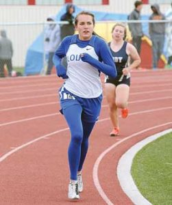 Lovell senior Jaclyn Caldwell strides along in the 3,200 meters on a cold day at the 3A West Regional Track Meet Friday in Cody. Caldwell qualified for State with a seventh-place finish. David Peck photo