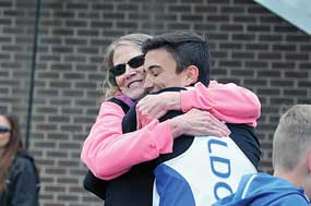 After setting a personal record hugs his grandmother Lynn Lundberg following the event. David Peck photo